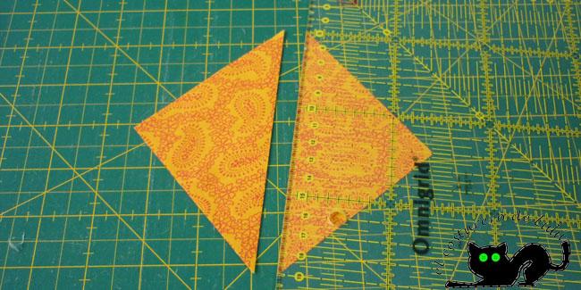Cortamos por la diagonal y obtenemos dos triángulos
